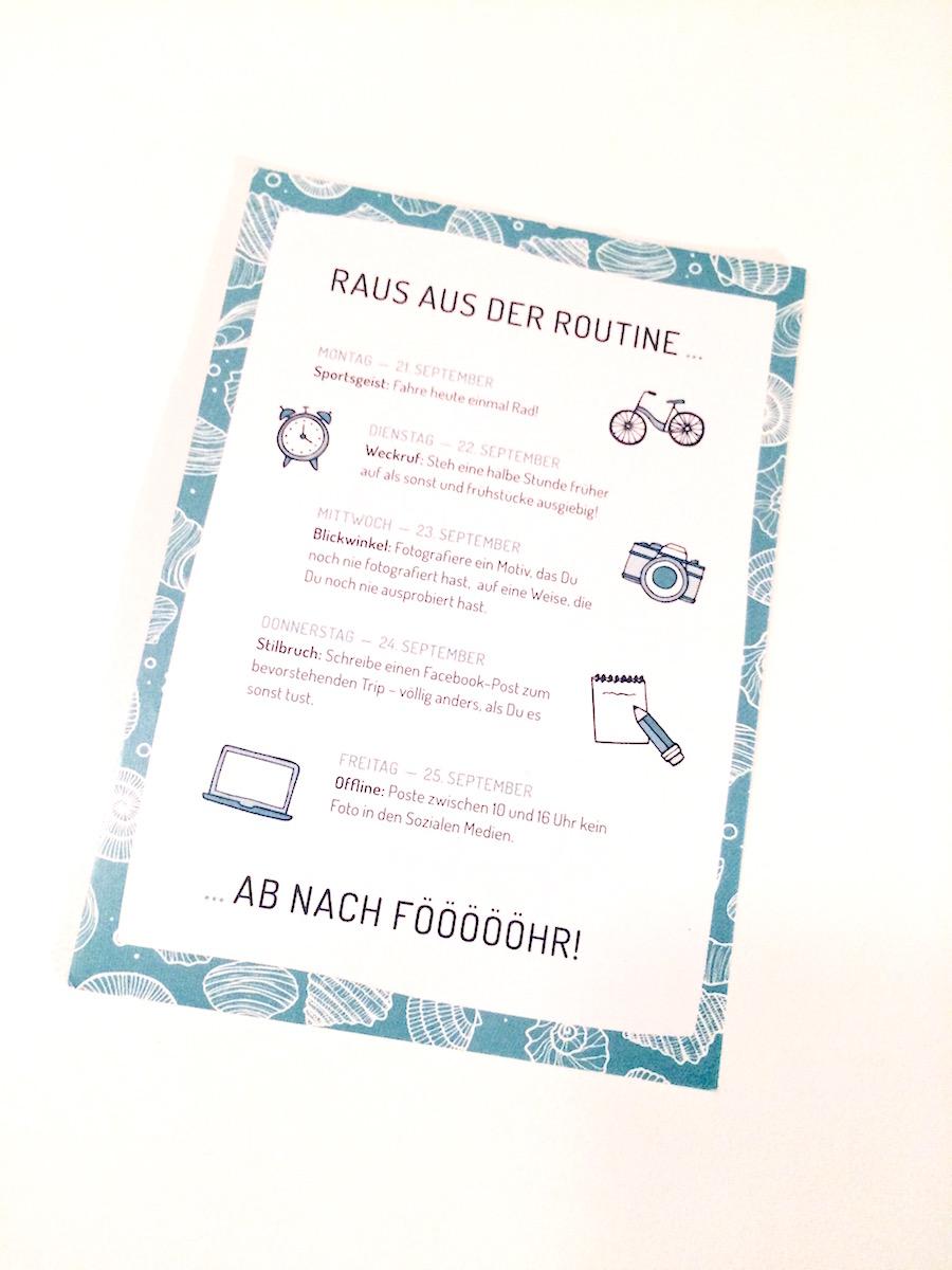 """Postkarte mit der Aufschrift """"Raus aus der Routine"""""""